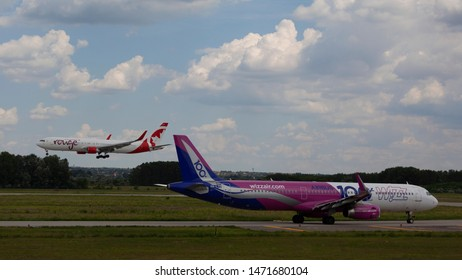 Hungary Budapest Aug 05 2019 : Passenger jets (like Wizzair) waiting for take off on a busy day at the international airport.
