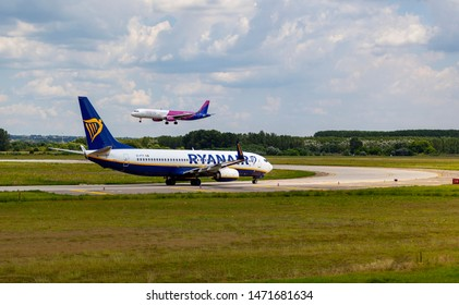 Hungary Budapest Aug 05 2019 : Passenger jets (like Lufthansa, Wizzair) waiting for take off on a busy day at the international airport.