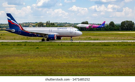 Hungary Budapest Aug 05 2019 : Passenger jets (like Aeroflot, Wizzair and Lufthansa) waiting for take off on a busy day at the international airport.