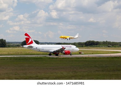 Hungary Budapest Aug 05 2019 : Passenger jets (like Eurowing and  Wizzair ) waiting for take off on a busy day at the international airport.