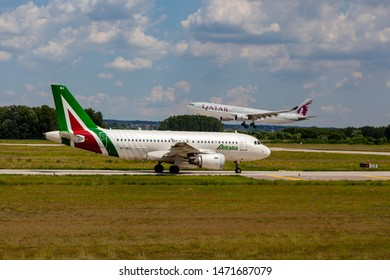 Hungary Budapest Aug 05 2019 : Passenger jets (like Alitalia and  Qatar) waiting for take off on a busy day at the international airport.
