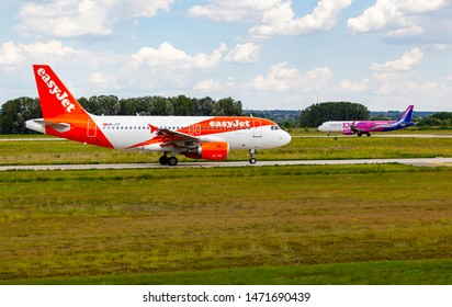 Hungary Budapest Aug 05 2019 : Passenger jets (like Easyjet and  Wizzair) waiting for take off on a busy day at the international airport.