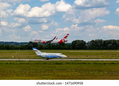 Hungary Budapest Aug 05 2019 : Passenger jets (like Private Jet and Air Canada,) waiting for take off on a busy day at the international airport.