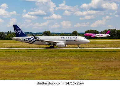 Hungary Budapest Aug 05 2019 : Passenger jets (like Skyteam - Air France -  and  Wizzair) waiting for take off on a busy day at the international airport.