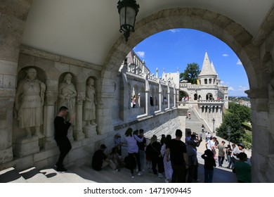 Hungary, Budapest, June 3, 2019. Wonderful summer view of tourists on the stairs in the arch and sculptures in the Fisherman's Bastion which is one of the attractions of Budapest