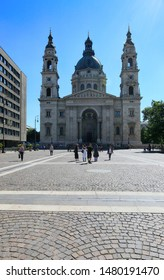 Hungary, Budapest, June 3, 2019. St Stephen's Basilica - Budapest's main temple and tourists on a city street on a sunny summer morning