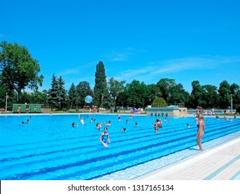 Hungary, Budapest - June 5, 2018: Palatinus Bath on Margaret island. People swim and play with the ball in the water. Open-air swimming pools with thermal water for rest and healthy lifestyle.
