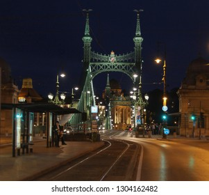 Hungary; Budapest; May 13, 2018. Street and empty Liberty bridge on Danube river in Budapest at night.