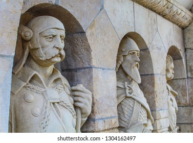 Hungary; Budapest; May 13, 2018. Three stone statues in the Fishermans Bastion in Buda Castle.