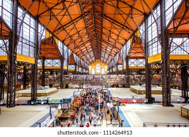 HUNGARY, BUDAPEST - MAY 19, 2018: Interior of the famous Great Market hall crowded with people, this building is largest and oldest indoor market in Budapest, Hungary