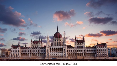 Hungary, Budapest Parliament view from Danube river. Dramatic clouds