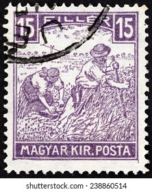 HUNGARY - CIRCA 1916: A stamp printed in Hungary shows harvesters, circa 1916.