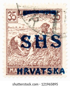 HUNGARY - CIRCA 1919: A stamp printed in Hungary shows farmers harvest, circa 1919