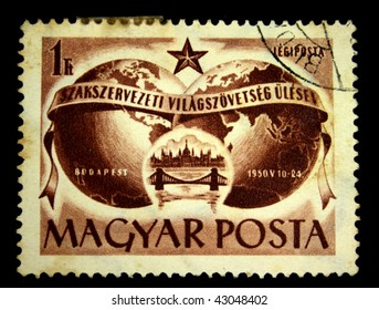 HUNGARY - CIRCA 1950: A Stamp printed in Hungary shows The slogan - Workers of the world unite - against the background of the two hemispheres of the Earth and the bridge over the Danube, circa 1950