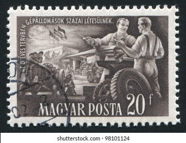 HUNGARY- CIRCA 1951: A stamp printed by Hungary, shows tractor manufacture, circa 1951
