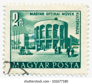 HUNGARY - CIRCA 1953: A stamp printed in the Hungary shows Optical works house of culture in Budapest, circa 1953