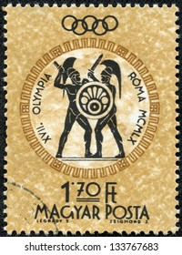HUNGARY - CIRCA 1960: A post stamp printed in Hungary shows gladiators, devoted Olympic games in Rome, circa 1960