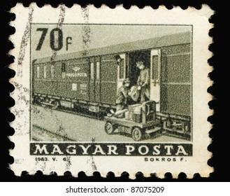 HUNGARY - CIRCA 1963: A stamp printed in Hungary shows postman and train, circa 1963
