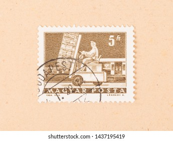 HUNGARY  - CIRCA 1964: A stamp printed in Hungary shows working at a trainstation, circa 1964
