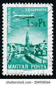 "HUNGARY - CIRCA 1966: A stamp printed in Hungary from the ""Plane over Cities served by Hungarian Airways"" issue shows Copenhagen, circa 1966."