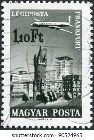 HUNGARY - CIRCA 1966: A stamp printed in Hungary, is depicted in Frankfurt am Main, aircraft, Eschenheimer Turm and Eschenheimer Gate, circa 1966