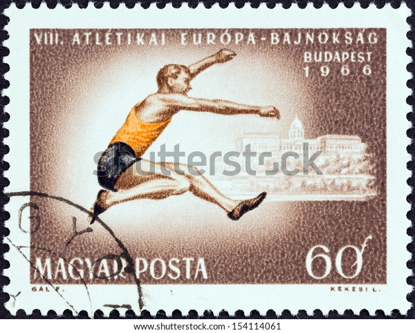 """HUNGARY - CIRCA 1966: A stamp printed in Hungary from the """"8th European Athletic Championships, Budapest"""" issue shows Long jump, circa 1966."""