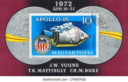 HUNGARY - CIRCA 1972: stamp printed by Hungary, shows Apollo 16 capsule, astronaut and badge, circa 1972
