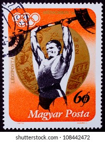 HUNGARY - CIRCA 1973: A stamp printed in Hungary showing weight-lifter, circa 1973