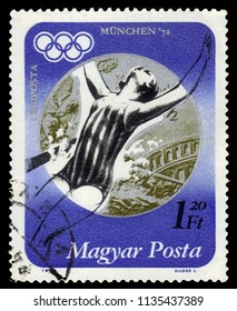 """HUNGARY - CIRCA 1973 : A stamp printed in Hungary shows silver medalist Andrea Gyarmati, hungarian swimmer and Olympic emblem, from the series """"Summer Olympics 1972, Munich"""", circa 1973"""