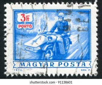HUNGARY - CIRCA 1973: stamp printed by Hungary, shows mailman on motorbike, circa 1973