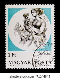 HUNGARY - CIRCA 1974: A stamp printed in Hungary showing mother and her baby, circa 1974