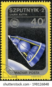 HUNGARY - CIRCA 1975:: A stamp printed in Hungary, presents Sputnik, the second spacecraft launched into Earth orbit, on November 3, 1957, carry a living animal, a dog named Laika, circa 1975