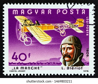 """HUNGARY - CIRCA 1978: A stamp printed in Hungary from the """"Pilots and Aircrafts"""" issue shows Louis Bleriot and English Channel, circa 1978."""