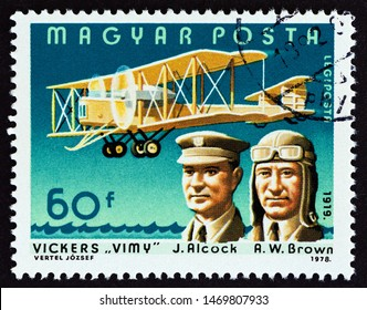 """HUNGARY - CIRCA 1978: A stamp printed in Hungary from the """"Pilots and Aircrafts"""" issue shows John Alcock and Arthur Whitten Brown, first non-stop transatlantic flight, 1919, circa 1978."""