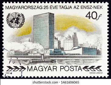 """HUNGARY - CIRCA 1980: A stamp printed in Hungary from the """"25th Anniversary of the Membership in the UN"""" issue shows United Nations Secretariat Building, New York, circa 1980."""