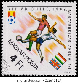 """HUNGARY - CIRCA 1982: A stamp printed in Hungary from the """"World Cup Football Championship, Spain """" issue shows Hungary v. England, 1962, circa 1982."""