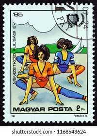 "HUNGARY - CIRCA 1985: A stamp printed in Hungary from the ""International Youth Year"" issue shows Women exercising, circa 1985."