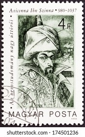 "HUNGARY - CIRCA 1987: A stamp printed in Hungary from the ""Pioneers of Medicine (1st series) "" issue shows Avicenna (Kanun book of medical rules), circa 1987."