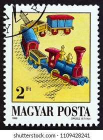 """HUNGARY - CIRCA 1988: A stamp printed in Hungary from the """"Exhibits in Toy Museum, Kecskemet"""" issue shows  Steam Train, circa 1988."""