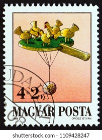 """HUNGARY - CIRCA 1988: A stamp printed in Hungary from the """"Exhibits in Toy Museum, Kecskemet"""" issue shows Pecking chicks, circa 1988."""