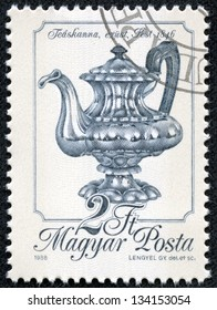 """HUNGARY - CIRCA 1988: A stamp printed in Hungary shows Silver Teapot, Pest, 1846, with the same inscription, from the series """"Metal Work"""", circa 1988"""