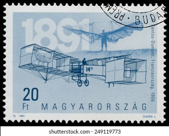 "HUNGARY - CIRCA 1991: Stamp printed in Hungary from the ""The 100th Anniversary of Airplanes"" issue shows Santos and Dumont 1906, circa 1990."