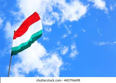 Hungary flag on sky background