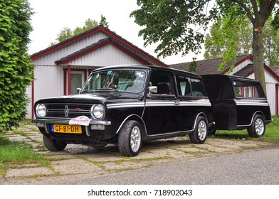 HUNGARY - May, 2012: Black classic Austin Mini Cooper retro vehicle parked on the road against the background of a house at the International Mini Meeting 2012. Automotive photography. Retro car.