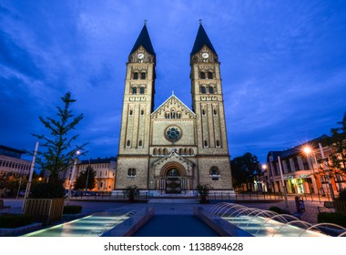 Nyiregyháza, Hungary - May 26, 2018: Night view on The twin-towered Nyiregyháza's Roman Catholic church with the newly built fountain in the foreground