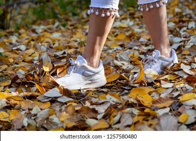 Hungary Oct 25 2018:  Lady walks in the foliage leisurely.