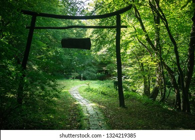 Visegrád, Hungary - September 12, 2017: Trail leads into the forest under a wooden gate, in the valley of Apátkút.