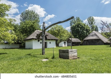 HUNGARY, SOSTOI, 05-17-2017. traditional houses with draw well  in the open air museum of Sostoi