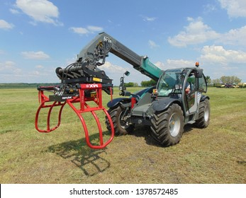 HUNGARY, TISZACSEGE - May 8, 2018: Kramer telehandler close-up with a red bale handler.