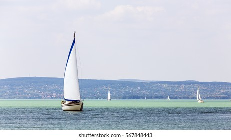 Hungary's largest freshwater lake, Lake Balaton. The boat extracted sail gliding on water